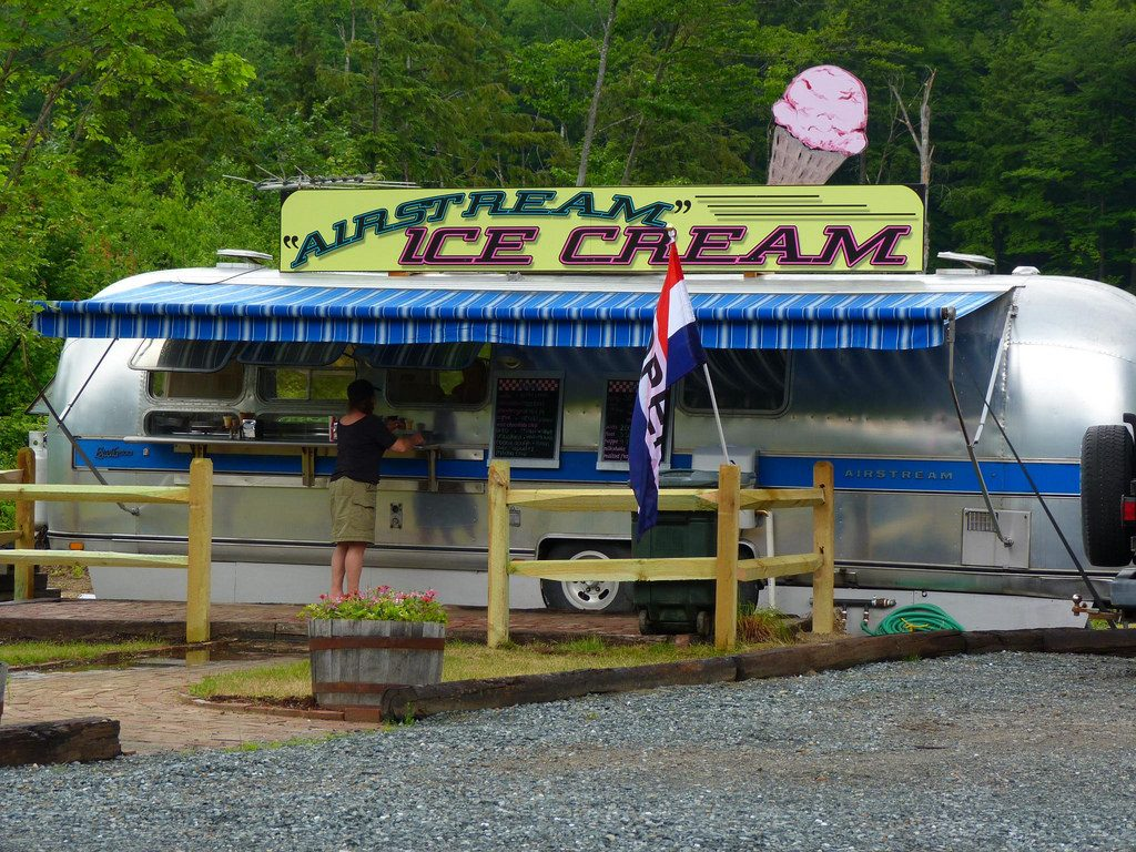 A vintage Airstream that doubles as an ice cream stand in New Hampton, NH proves the popularity of Airstreams among creative businesses. Photo by Flickr user Rusty Clark.